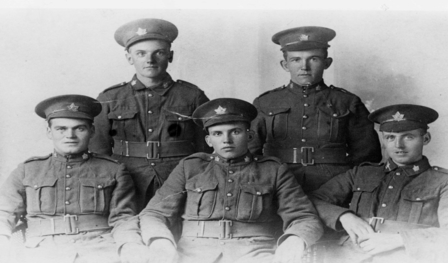 Photo of five men in military uniforms from 1916