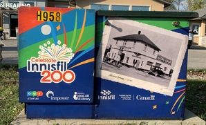Image of a utility box featuring the Celebrate Innisfil 200 logo and an image of the Alcona Garage