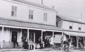 Image of a crowd of people gathered in front of the Lefroy Post Office and General Store in the 19th century