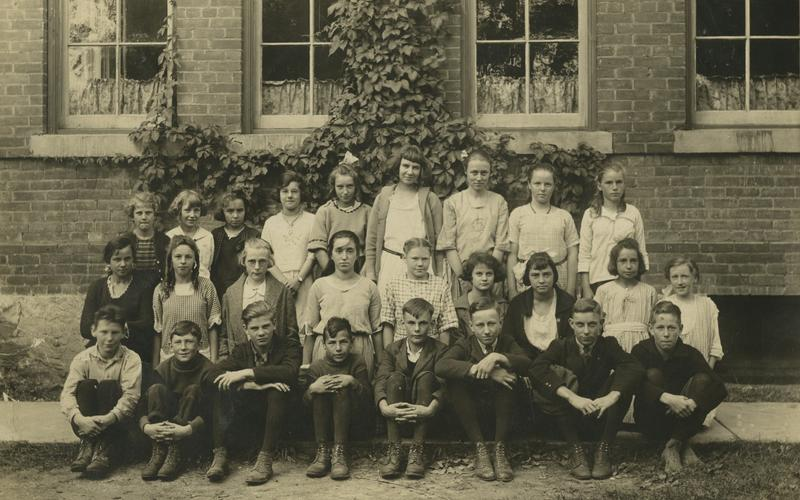 Image of three rows of students in front of Cookstown school