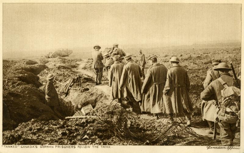 Postcard of Canadian soldiers ushering German prisoners of war behind a tank